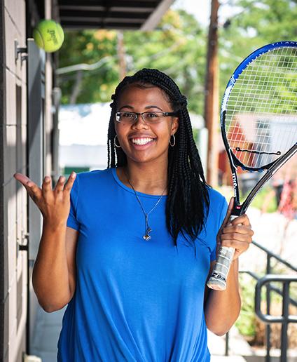 Brie Hollins plays tennis