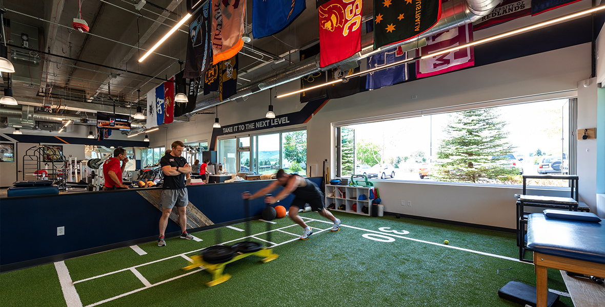 an athlete pushing a weighted sled at Next Level